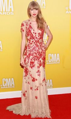 2012 CMA Awards Fashion: Best Dressed List - Fashion Key  A strong second place: Taylor swift donning a nude and red floral embroidered lace gown by Jenny Packham with Neil Lane accessories.