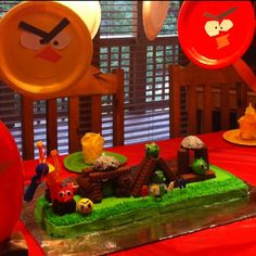 Angry birds cake made with Little Debbie snack cakes and frosted doughnut holes.