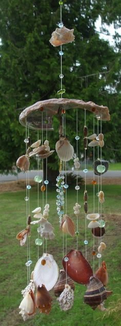 Handmade seashell wind chimes with glass by . Handmade seashell wind chimes with glass by . Seashell Wind Chimes, Diy Wind Chimes, Seashell Art, Glass Wind Chimes, Beach Crafts, Fun Crafts, Seashell Projects, Seashell Crafts Kids, Summer Deco