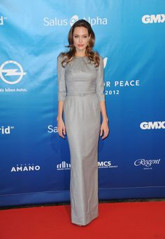 Angelina Jolie picked another gray dress — this one long-sleeved and by Ralph & Russo — to attend the C...