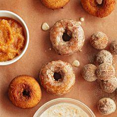 Cinnamon-spiced Applesauce Doughnuts. Secret ingredient: buttermilk. Find more irresistible apple desserts: www.bhg.com/recipes/desserts/other-desserts/apple-desserts/?socsrc=bhgpin100512applesaucedoughnuts