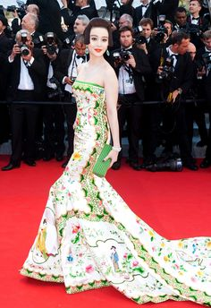 The Chinese actress wore an elegant pale strapless gown by her friend Christopher Bu, decorated with bright floral designs and traditional Tang dynasty stories. Inspired by a porcelain vase, the ancient vibe of her dress was complimented by her hair, which was pinned to look like a young girl from the Tang dynasty.
