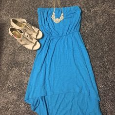 Express strapless dress Worn once, no damage or stains, shorter in front longer in back, stretchy band on the top, very flowy and cute! Open to reasonable offers, no trades Express Dresses High Low