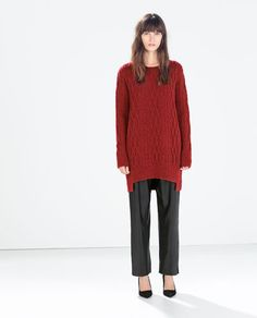 ASYMMETRIC CABLE-KNIT SWEATER