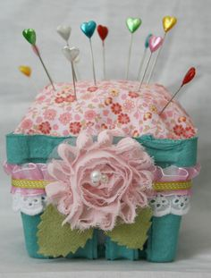 Make a Berry Basket Pincushion - Target and WM both sell plastic berry baskets that would work, too.  How cute!