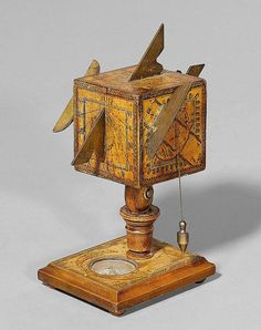 A WOOD AND PAPER CUBE SUNDIAL, Germany, 2nd half of 18th c.Verso sign. D.BERINGER. H ca. 19 cm.