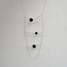 Geometric black necklace - MIRO. €26.00, via Etsy.
