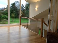 Oak Stairs with a Glass Balustrade on a gallery landing Oak Stairs, Glass Stairs, Glass Stair Balustrade, Stair Kits, Contemporary Stairs, Concrete Wood, Banisters, Home Reno, Staircases