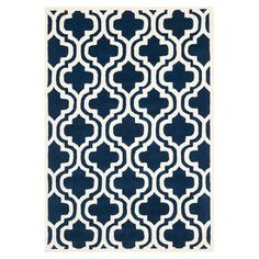 Anchor your living room seating group or define space in the den with this artfully hand-knotted wool rug, showcasing a quatrefoil-inspired trellis motif for...