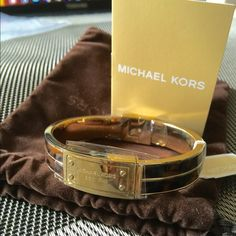Michael Kors Logo plaque bangles NWT. Authentic Michael Kors gold tortoise shell print bangle. Brand new. The clear wrapping still on. I have a hard time to list it because it is so chic! Love it so much  But it is too big for me as picture shows. Comes with original manufacturer accessories. tradePayPal. Michael Kors Jewelry Bracelets