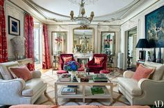 Mirrors, including one hung over closed double doors, expand the proportions of the living room.