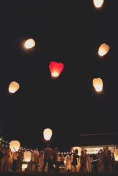 floating skylanterns at the end of the wedding reception // photo by TaylorLordPhotography.com