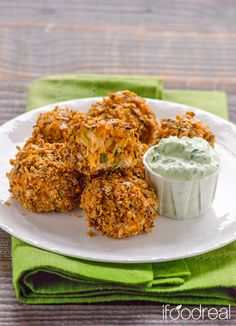 Lighter Buffalo Chicken Bites with Cilantro Yogurt Dip - Lightened up with hummus and whole gluten free crackers. Perfect for football/hockey get togethers and as a party appetizer this Holiday Season.