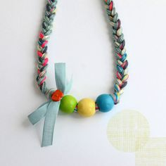 handmade braided necklace, look at the ribbon embellishment and combination of colours in the braid