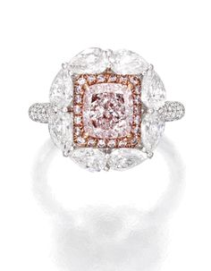 18 KARAT TWO-COLOR GOLD, LIGHT PINK DIAMOND AND DIAMOND RING. Centered by a cushion-cut Light Pink diamond weighing 1.52 carats, framed by small round diamonds of pink hue weighing .51 carat, bordered and accented by round and pear-shaped diamonds weighing 2.32 carats