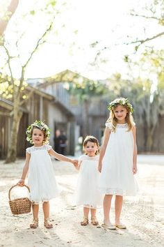 Flower girls in white dresses with ivy crowns | Brides.com