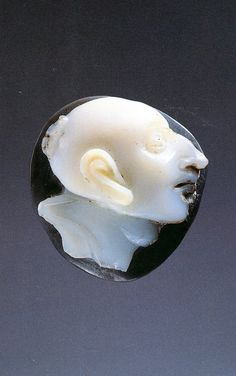 A Roman Nicolo Cameo with the Head of a Grotesque with a Top-knot | F 1st-2nd  cent-BC