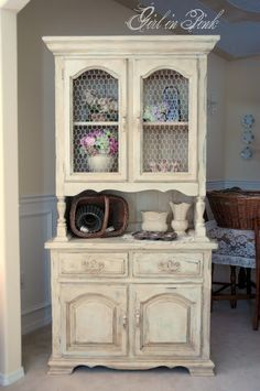 For this piece, I started with one rough coat of Annie Sloan's Versailles followed by one coat of Old White.  Next, I distressed all of the ...