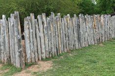 cloture de jardin en troncs bruts