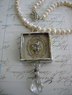 combination of pearls and crystal with soldered charm