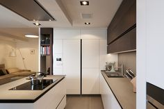 minimalistic kitchen with wooden elements and black accents