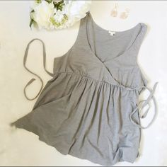 J. Crew // Wrap Front Summer Tank - gray This lightweight summer tank is the best top for those hot summer days. Pair this with some bright white jeans and cute wedges and you'll have the perfect summer daytime look. Wrap front with a safety pin hidden to make it less revealing but that can be removed to show more. Made for small busts. Tie back feature to add a fitted waist. J. Crew Tops Tank Tops