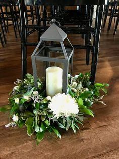 Beautiful way to decorate the aisle for your wedding with lanterns and mixed greenery