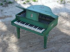 US $650.00 -- Antique Green Schoenhut 3-octave toy grand piano with both white and black keys.  Circa 1920s to 1930s.  I just bought this one.