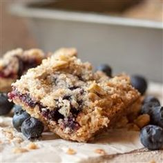 Blueberry Crumble Bars: 1-1/2 cups all-purpose flour 1-1/2 cups quick-cooking or old-fashioned oats 1-1/2 cups sugar, divided 1/2 teaspoon baking soda 3/4 cup cold butter 2 cups blueberries 2 tablespoons cornstarch 2 tablespoons lemon juice 1/2 t cinnamon