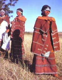 Mfengu (Xhosa) women wearing traditional red capes and skirts, South Africa