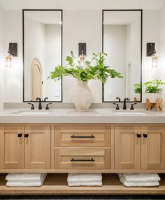 This might be our favorite master bathroom design of all time! This double sink vanity looks modern with the two tall mirrors above the black sink hardware. Adding a plant with elevate any room! Master Bathroom Vanity, Bathroom Vanity Designs, Modern Master Bathroom, Bathroom Interior Design, Double Sink Bathroom, Spa Master Bathroom, Neutral Bathroom, Modern Bathroom Vanities, Modern Bathrooms