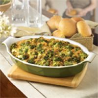 Broccoli and Cheese Casserole  1 10 3/4-oz. can Campbell's® condensed cream of mushroom soup  1/2 C. milk  2 tsp. yellow mustard  1 16-oz. bag frozen broccoli florets, thawed  1 C. shredded cheddar cheese  1/3 C. dry bread crumbs  2 tsp. butter, melted