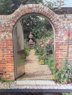 This is my parents' secret walled garden in England, where my father, David Hicks, romantically thought my sister or I might get engaged, with the smell of rose and peony petals all around.....