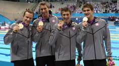 Left to right: Brendan Hansen, Matthew Grevers, Michael Phelps and Nathan Adrian pose following the medal ceremony for the men's 4x100-meter medley on Saturday, August 4.  Phelps went out with a WOW!  18 gold medals.