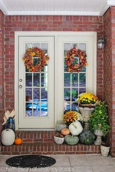Beautiful autumn fall porch with pumpkins mums and Indian corn from Unskinny Boppy