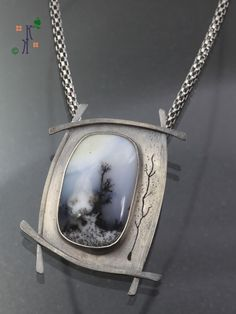 """""""Reaching for the Sky"""", dendritic opal set in sterling silver from Kathleen Krucoff's Treescape Series."""