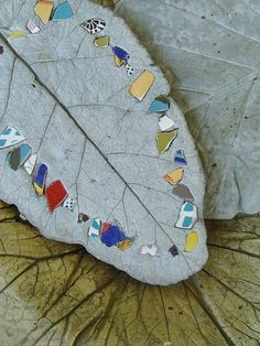 Mosaic leaf in cement shaped lrg leaf. for out side decor