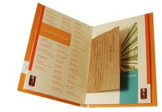 """an Annual report for theMid-Ohio Foodbank: The cover encompasses the theme of collecting food, a main objective for the foodbank and applies it to the report itself in the form of a grocery bag. The die cut section reads """"shop"""" from the exterior and is realized as """"Shop for others"""" when the cover is removed. The exterior of the book is modeled after the famous Campbell's soup print series by Andy Warhol."""