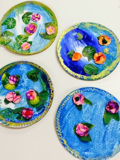 Monet - 2nd grade art lesson: tempura paint on cardboard rounds, flowers painted on paper with dots, tissue centers, and lily pads done with oil pastels and green paper