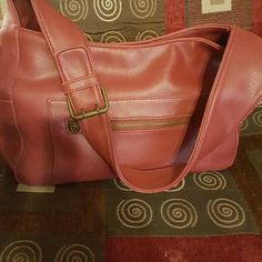 BRAND NEW NEVER USED Dockers over the shoulder bag Leather bag with several pockets an inside zipper in the middle zipper on the side into pockets on the other side also two outside zippers. The buckle on the strap allows you to adjust the length of the strap. Dockers Bags Shoulder Bags