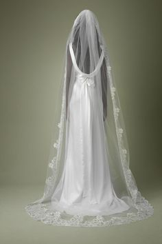 full-length lace veil. Forms a little train-perfect for over a simple/lace dress