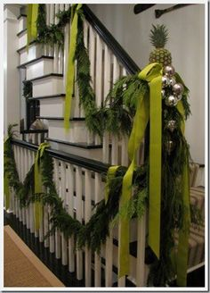 What a beautiful stairway garland.