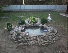 DIY Pond From Old Tractor Tire.  Love the solar lantern on this one.  And the built up back that could be a fountain.  ^^
