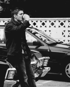 Dean leaning on the front of the Impala drinking coffee is so much porn to me! lol
