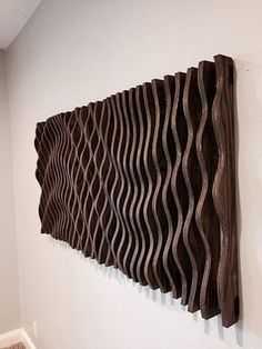 This parametric wall wave is a visually intriguing piece of wall art. Comprised of 47 individually cut pieces of 3/4 cabinet grade oak plywood that spaces apart to displays a sweeping and organic parabolic wave. This piece is 58 long, 28 wide, and 3 thick at its thickest. It
