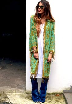 long, fringed, gorgeous green shawl over a long white dress and jeans