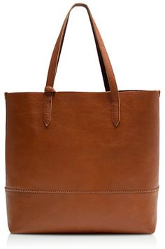 Downing tote  It proves your work bag, errands bag, gym bag and going-out bag can all be the same bag. The special leather gets softer with use, which is great since you'll be using it all the time.