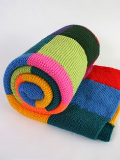 Large Knitted Blanket: Huge blanket handmade from a rainbow of squares makes the cosiest bedspread.