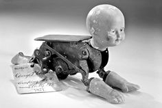 Creeping baby automaton (first patent by Robert Clay, 1871)    Well, that's not the stuff nightmares are made of AT ALL.