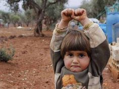 This 4 years Syrian kid surrenders to a photographer thought he was holding a gun in his hand. It is shocking to see how traumatized kids are in Syria. Now this image is viral all over the internet. itimes.com